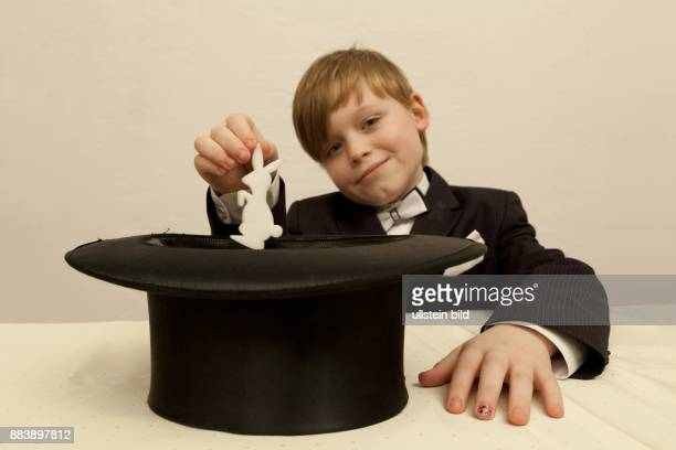 young boy dressed up as a magician