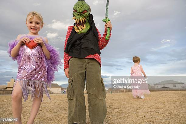 Young boy dressed up as a monster and young girl dressed up in a 1920s flapper costume