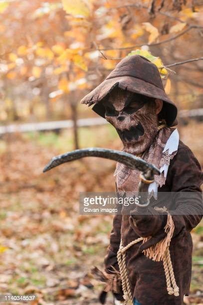 young boy dressed up in spooky scarecrow costume for halloween - scarecrow faces stock photos and pictures