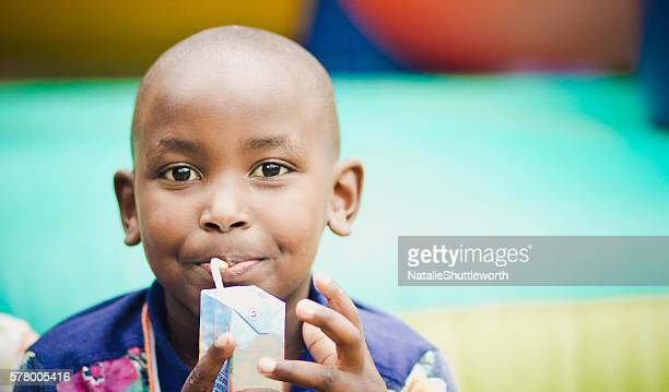 young boy drinking a juice box - juice carton stock photos and pictures