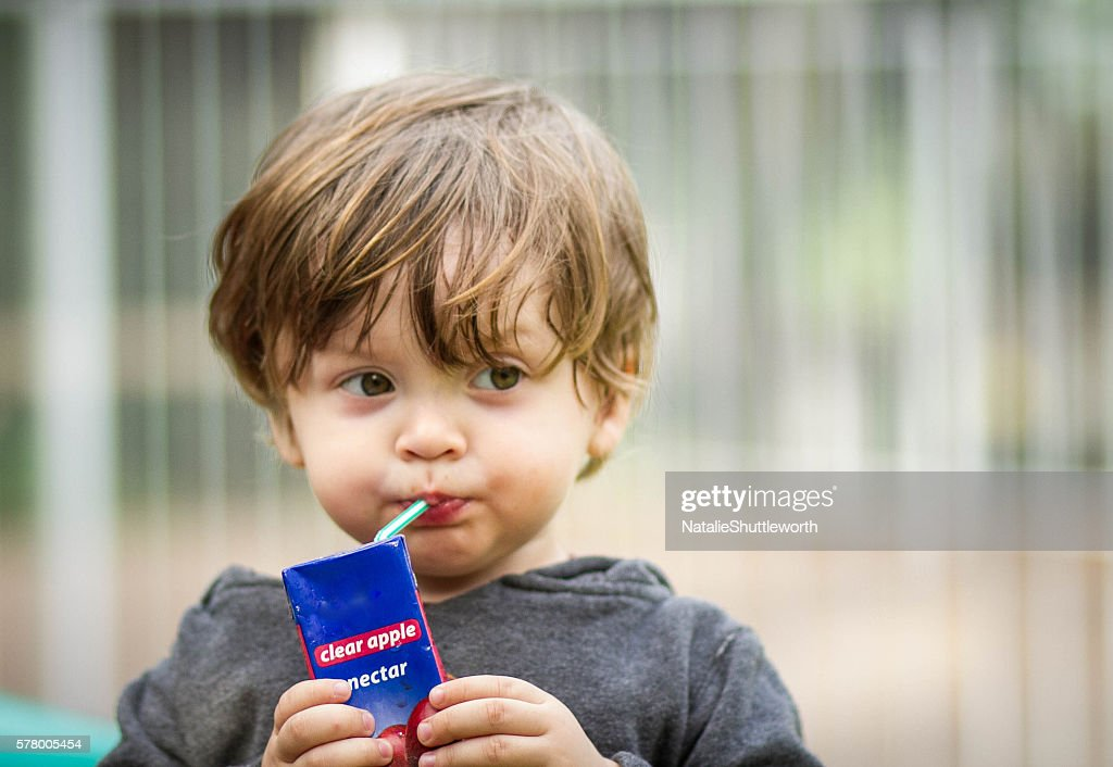 Young Boy Drinking a Juice Box : Stock Photo