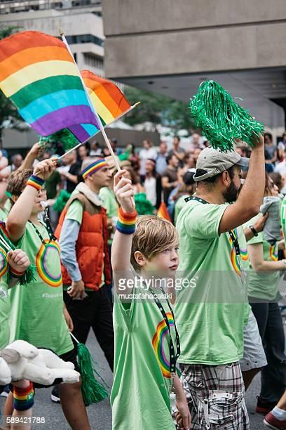 young boy during the gay parade montreal 2016 - intersex photos et images de collection