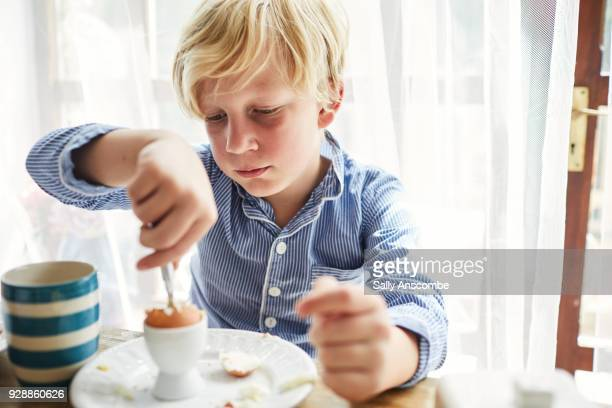Young boy eating breakfast