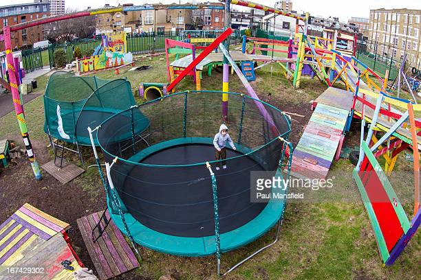CONTENT] A young boy enjoys bouncing on a trampoline at Weavers Adventure Playground in Bethnal Green East London