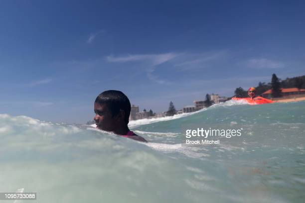 A young boy enjoys his first ever visit to the beach at South Narrabeen Beach on January 18 2019 in Sydney Australia The 40 children from Far North...