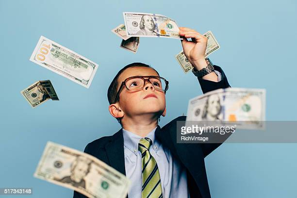 Young Boy Examines Money Falling from Sky