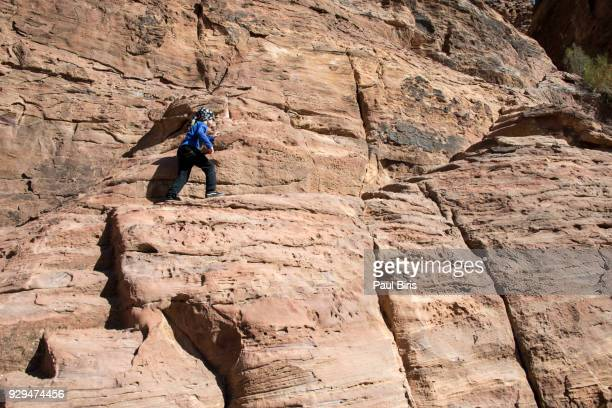 young boy exploring petra, jordan - sandstone stock pictures, royalty-free photos & images