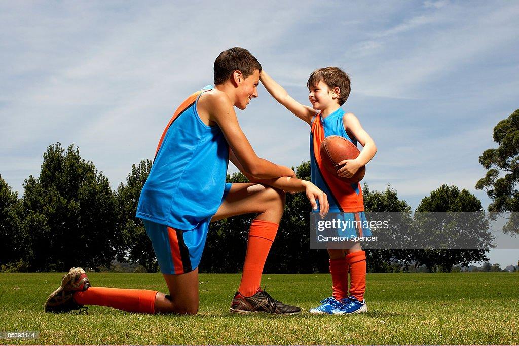 Young boy facing older boy : Stock Photo