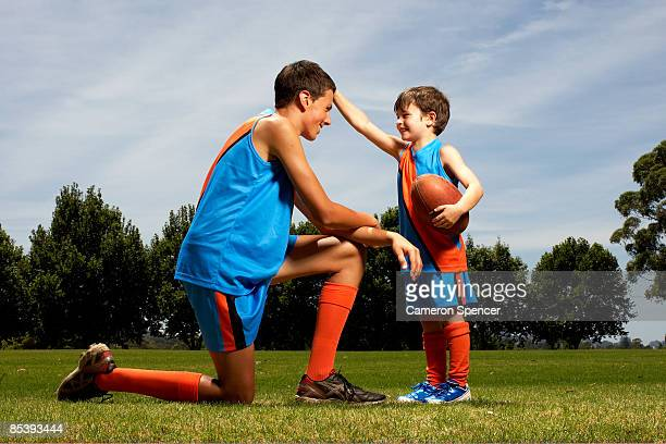 young boy facing older boy - cameron young stock photos and pictures