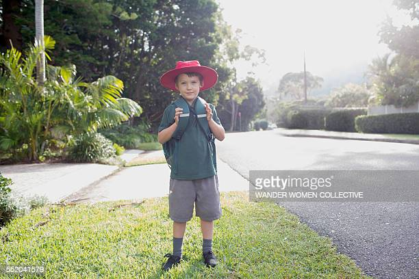 Young boy first day walking to school in Australia
