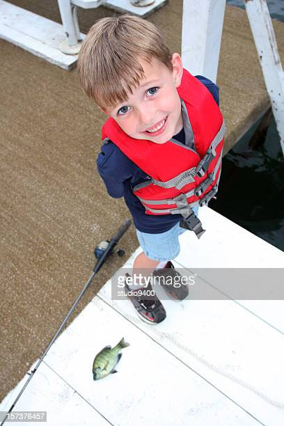 Young boy fishing on a dock