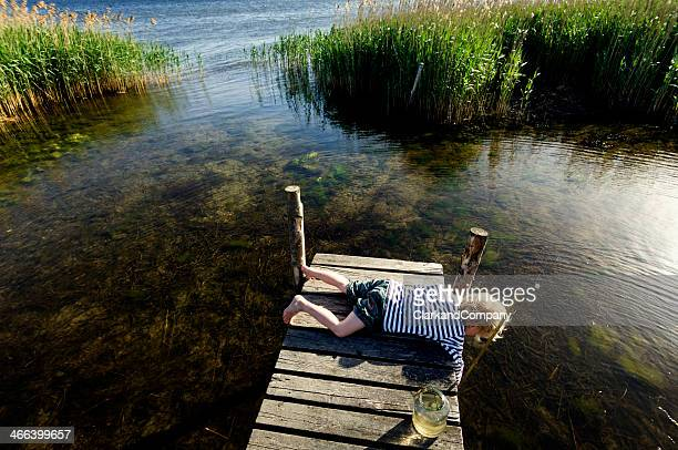 young boy fishing - jetty stock pictures, royalty-free photos & images