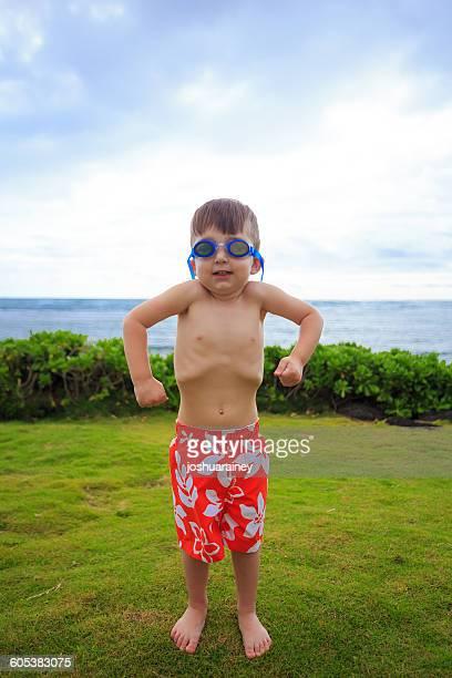 Young Boy Flexing Muscles, Oahu, hawaii, America, USA