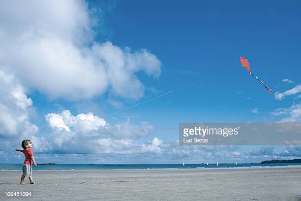 Young boy flying a kite