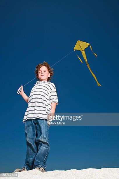 young boy flying a kite - captiva island stock photos and pictures