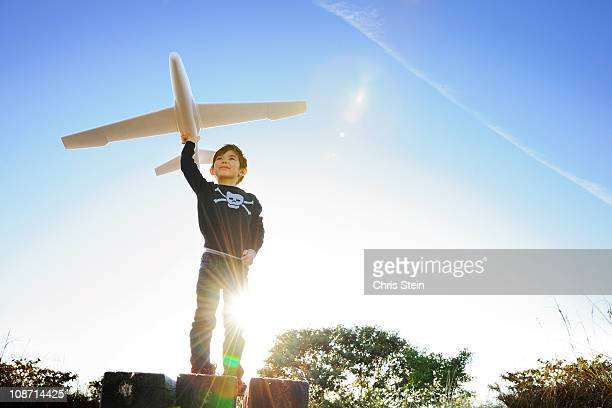Young Boy Flying A Plane