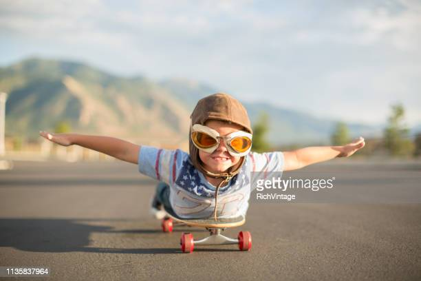 young boy flying on skateboard - customised stock pictures, royalty-free photos & images