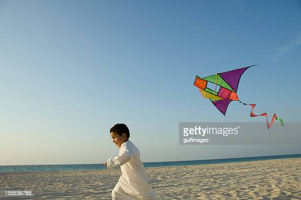 Young boy flying the kite