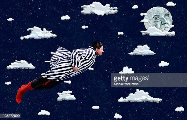 Young Boy Flying Through Cartoon Clouds