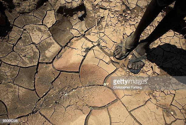 Young boy from the remote Turkana tribe in Northern Kenya stands on a dried up river bed on November 9, 2009 near Lodwar, Kenya. Over 23 million...