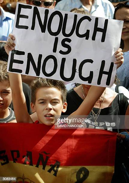 A young boy from the Spanish community holds a protest sign during a commemoration for the victims of the Madrid rail bombings in Sydney 14 March...