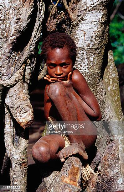 Young boy from Yakel kastom village in Banyan tree.