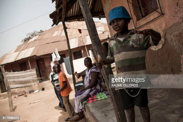 A young boy gestures in the Mindara neighbourhood in Bissau on Mardi Gras on February 13 2018 / AFP PHOTO / Xaume Olleros