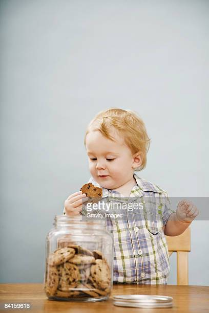 Young Boy Getting a Cookie from a Cookie Jar