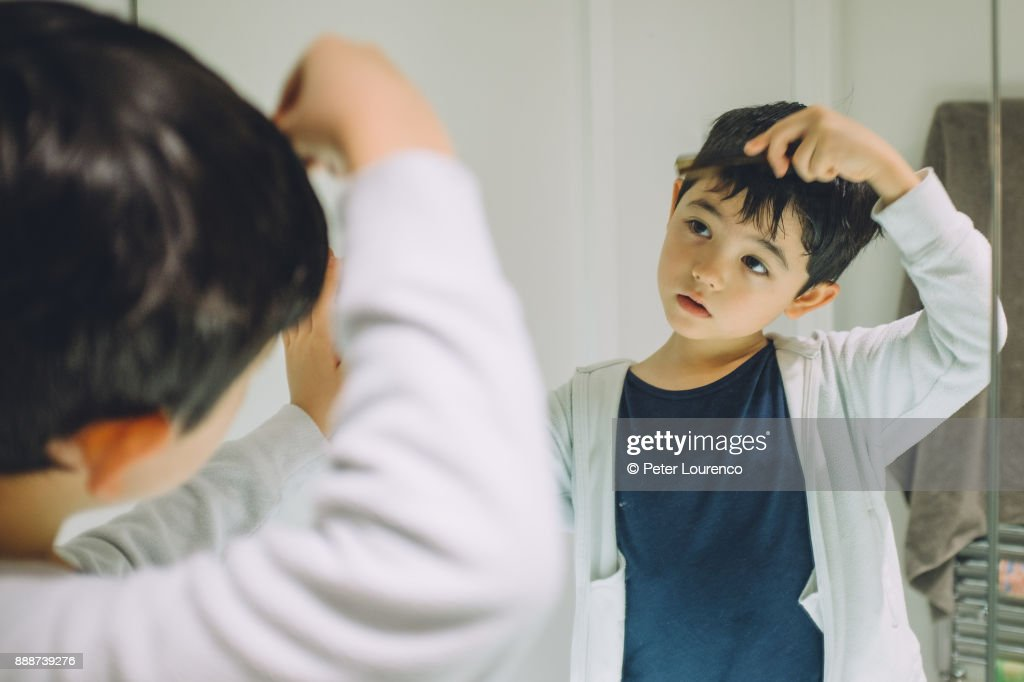 Young boy getting ready to go out. : Stock Photo