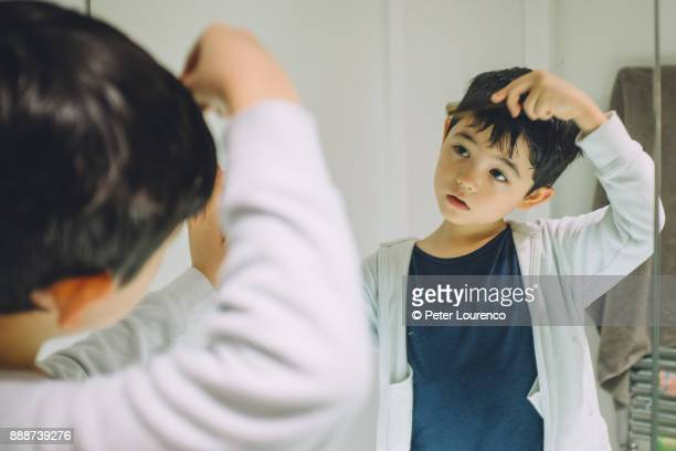 Young boy getting ready to go out.