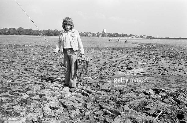 Young boy goes for a spot of fishing at dried out Edgbaston reservoir in Birmingham during the summer heatwave of 1976 9th August 1976