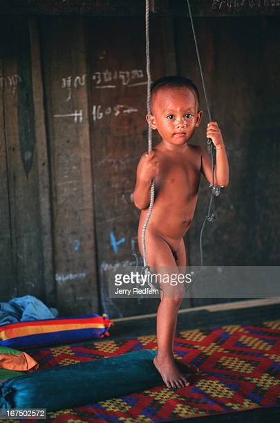 A young boy hangs out literally at the Cambodian Light Children Association Pat Noun started the Cambodian Light Children Association after he sold...
