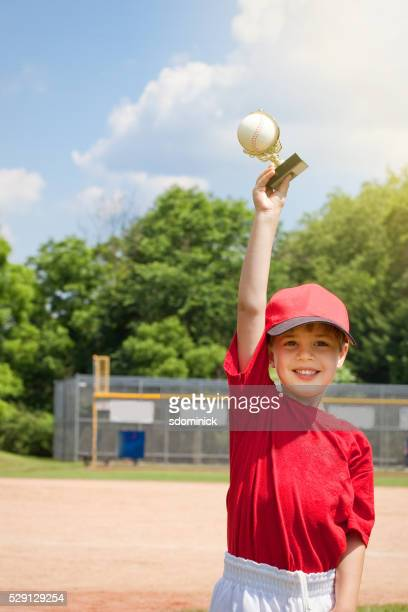Young Boy Happy Holding Baseball Trophy