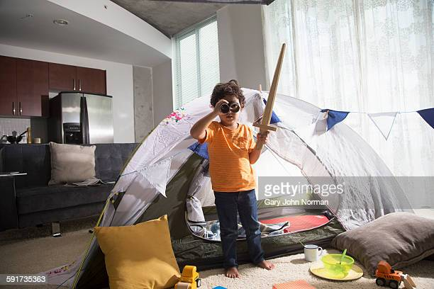 young boy has adventure indoors. - sword stock pictures, royalty-free photos & images