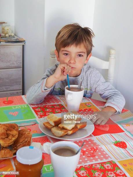 Young boy having breakfast at home