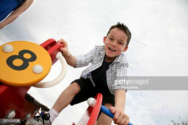 Young Boy having fun at a playground