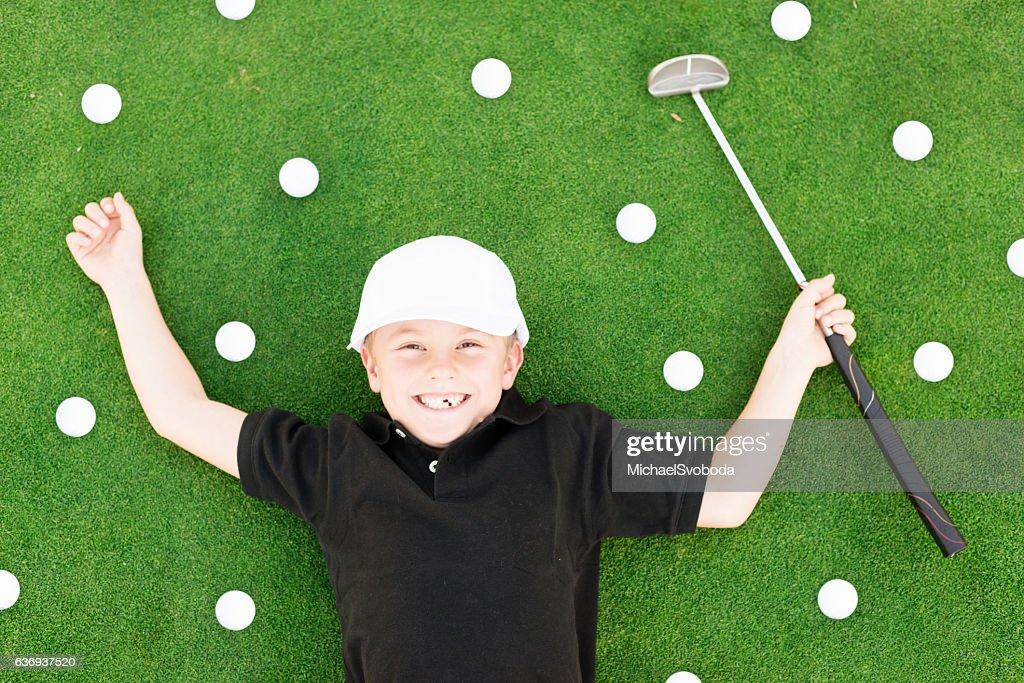 Young Boy Having Fun On Golf Course : Stock-Foto