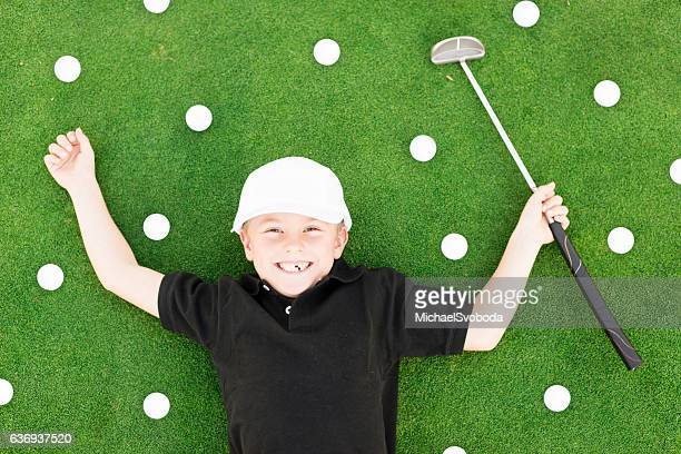 Young Boy Having Fun On Golf Course