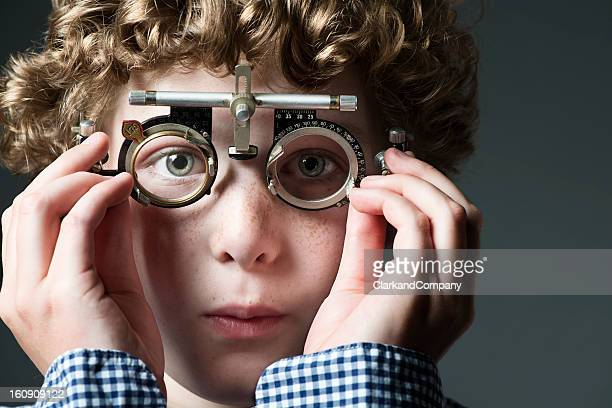 Young Boy Having His Eyes Checked at The Opticians
