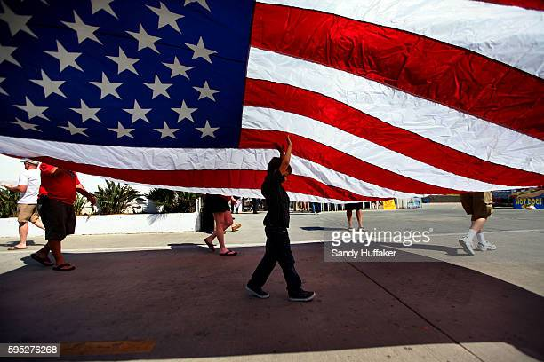 A young boy helps carry a large American flag during a California Tea Party protest rally in Oceanside California on Sunday Octobr 10 2010 Tea Party...