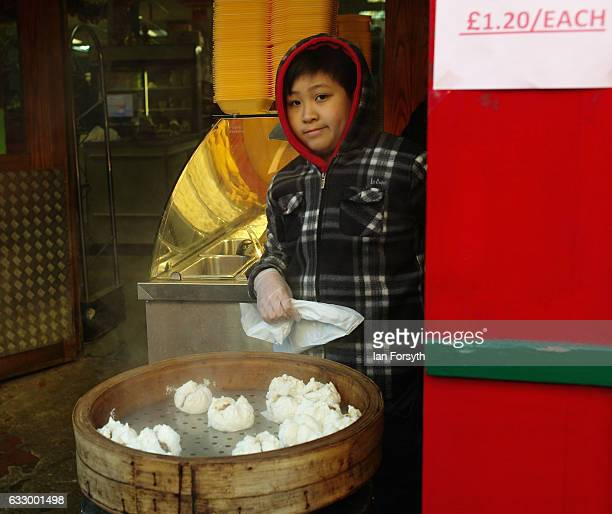 A young boy helps to prepare food during the Chinese New Year celebrations to mark The Year of the Rooster on January 29 2017 in Newcastle Upon Tyne...