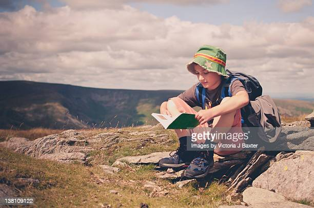 Young boy hiking in hills