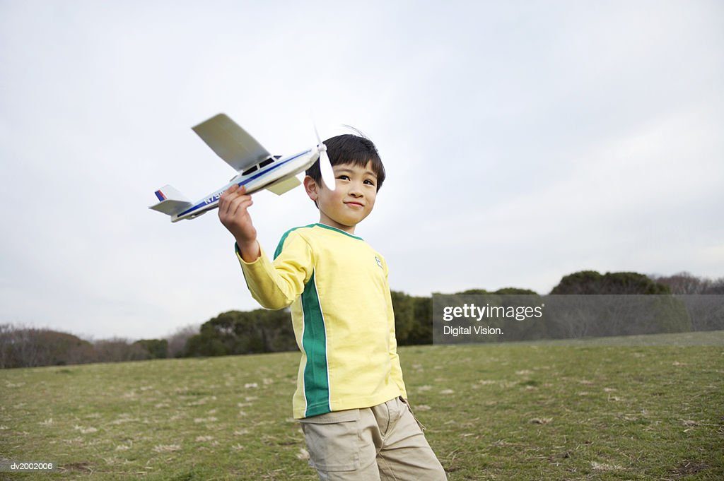 Young Boy Holding a Model Plane : Stock Photo