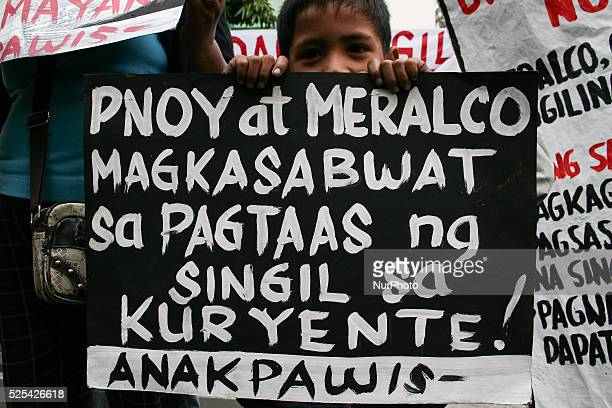 Young boy holding a poster against President Aquino and Meralco's alleged conspiracy to raise the power rates. -- Anakpawis Partylist held a protest...