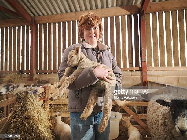 Young Boy Holding Lamb