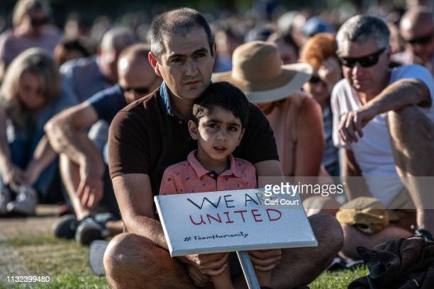 A young boy holds a placard as he takes part in a vigil to remember the victims of the Christchurch mosque attacks on March 24 2019 in Christchurch...