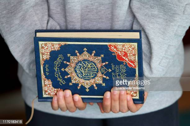 A young boy holds the Quran in his hands during weekend teachings of Arabic at the Al Noor Mosque on August 24 2019 in Christchurch New Zealand The...