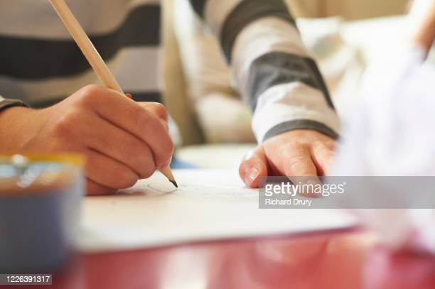 young boy home schooling - richard drury stock pictures, royalty-free photos & images