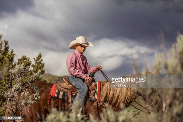 young boy horseback rider high desert - sagebrush stock pictures, royalty-free photos & images