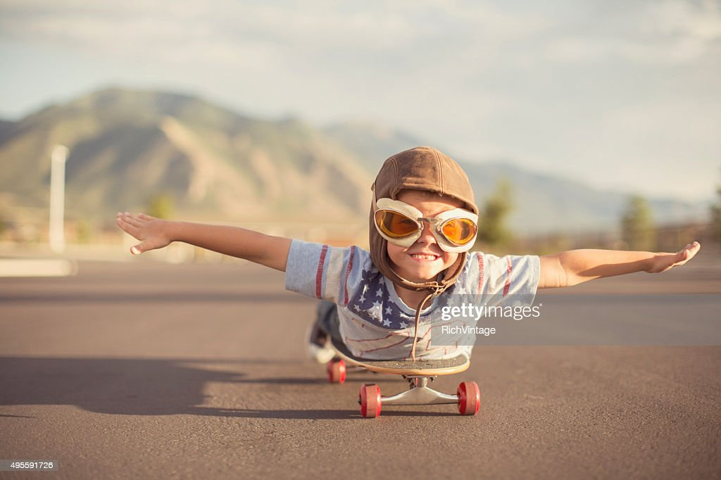 Young Boy Imagines Flying On Skateboard : Stock Photo